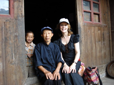 With a Miao man and his grand-son